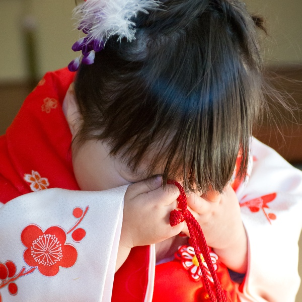 boy and girl in kimonos in Japanese Room, celebrating Shichi Go San,